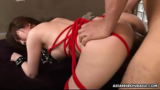 Squirting Oriental is bound up and used in a 3some