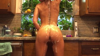 Riley Reid does the dishes bare