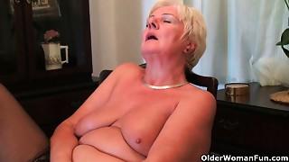 Sixty four year older and British grandmother Sandie rubs her older muff