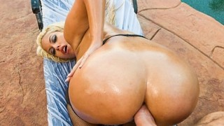Big-booty golden-haired hooker oils up her arse for some hardcore anal dance