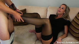 Kinky housewife in hose Brandi Love provides a chap with a footjob