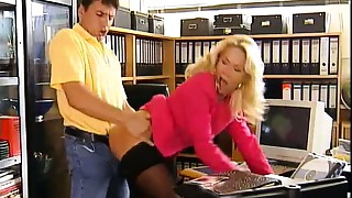 Glamorous office hooker getting pounded on her own desk