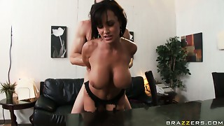 Buxom hooker Lisa Ann bonks hard doggystyle and gives a great titjob