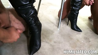 Abused Jackie Daniels licks cum off her girlfriend's boots
