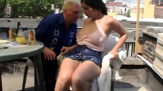 Perverted brunette hair young slut with suckable mambos provides elder ma with tugjob
