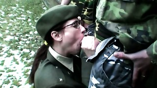 Unsightly dark brown Major Dita gives double oral pleasure to 2 perverted soldiers in MMF sex movie scene