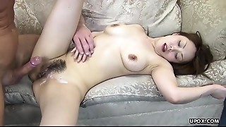 She's still twitching when this guy cums on her hirsute cum-hole